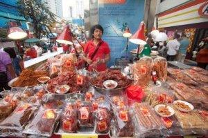 12444795-bangkok--january-12-man-cooking-and-selling-food-on-street-on-january-14-2012-in-bangkok-thailand-st